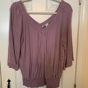 Dolman style with gathered waist